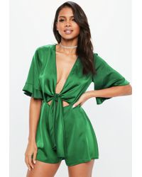 c33f036fa3e Missguided Green Striped Jersey Pompom Trim Playsuit in Green - Lyst