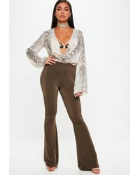 Missguided - Gold Slinky Kickflare Pants - Lyst