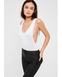 a477ed1717 Lyst - Missguided Sleeveless Scoop Back Ribbed Bodysuit White in White