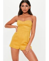 2980d625a4d Missguided Yellow Tie Back Pleated Shoulder Playsuit in Yellow - Lyst