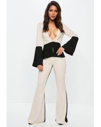 Missguided - Cream Contrast Kick Flare Trousers - Lyst