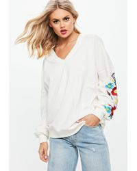 Missguided - White Floral Embroidered Sleeve V Neck Sweatshirt - Lyst