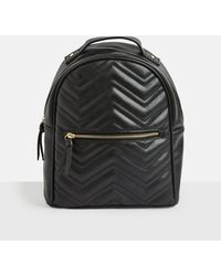 Missguided - Black Quilted Rounded Backpack - Lyst