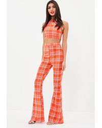 Missguided - Orange Check Print Kick Flare Pants - Lyst