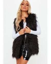 Missguided - Black Faux Shaggy Mongolian Fur Gilet - Lyst