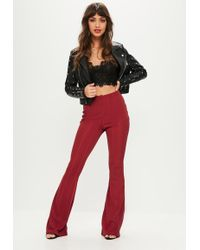 Missguided - Red Bandage Flared Trousers - Lyst