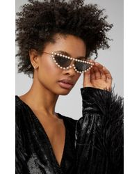 eb48bc29909d Gucci Pearl Studded Cat Eye Sunglasses In Black in Black - Lyst
