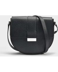 57d28000670 BOSS - Taylor Saddle Bag In Black Grained Calfskin - Lyst