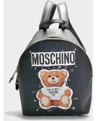 Moschino - Teddy Safety Pin Small Backpack In Black Calfskin - Lyst