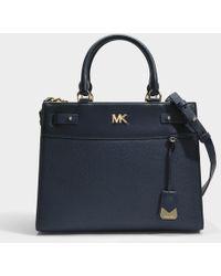 Michael Michael Kors Mott Uptown Mini Messenger Bag in Soft Pink Small Pebble Leather RT9t05hV1m