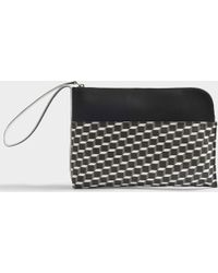 Pierre Hardy - Pouch Bag With Hand Strap In Black And White Cube Canvas And Calfskin - Lyst