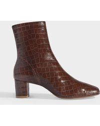 BY FAR - Bottines Sofia en Cuir Embossé Croco Marron - Lyst