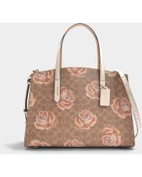 COACH - Charlie Carryall Bag In Brown And Chalk Canvas - Lyst