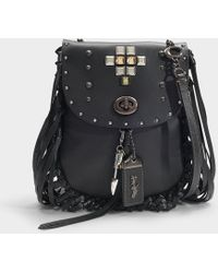 b15dbe68e70f COACH - Pyramid Rivets Fringe Saddle Bag In Black Leather - Lyst