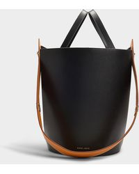 Danse Lente - Mini Lorna Bag In Black And Ocher Calfskin - Lyst