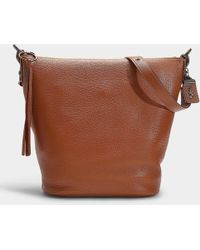 1c5d1109e ... france coach glovetanned pebble duffle bag in 1941 brown calfskin lyst  1deff facbe