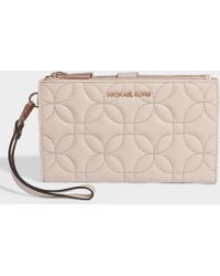 d55985700779 MICHAEL Michael Kors - Double Zip Wristlet In Soft Pink Quilted Lambskin -  Lyst
