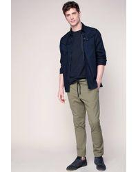 ELEVEN PARIS - Trousers - Lyst