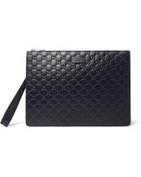 Gucci - Gg Debossed Leather Pouch - Lyst