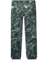Lanvin - Tapered Camouflage-print Cotton-twill Trousers - Lyst