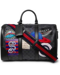 Gucci - Night Courrier Leather-trimmed Appliquéd Monogrammed Coated-canvas Holdall - Lyst