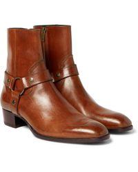 Saint Laurent | Wyatt Burnished-leather Harness Boots | Lyst