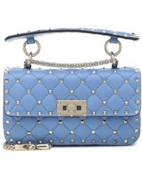 1a7243c45be7 Lyst - Valentino Rockstud Spike Small Leather Shoulder Bag in Blue