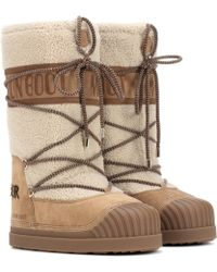 5801c7a9c1b1 Lyst - Moncler Shearling Snow Boots in Black
