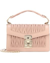 e5b2ac0fe860 Lyst - Miu Miu Matelassé Leather Shoulder Bag in Pink