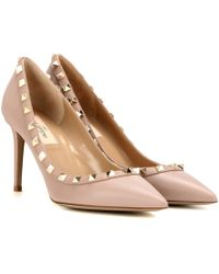 c1cf76e6685 Lyst - Valentino Rockstud Calf Hair and Leather Kitten Heel Pumps in ...