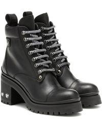 74c0dca22b619 Miu Miu Studded Leather Biker Boots in Black - Lyst