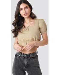 3468deff427 NA-KD Frill V-neck Puff Sleeve Blouse Beige in Natural - Lyst