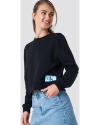 Calvin Klein - Monogram Logo Badge Sweatshirt Ck Black - Lyst