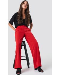 NA-KD - Flared Shiny Suit Pants - Lyst