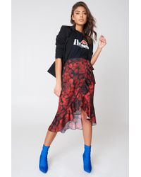 NA-KD - Wrap Over Satin Frill Skirt Black/red Flower - Lyst
