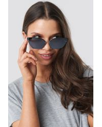 a34b368f89d Lyst - Women s Cheap Monday Sunglasses Online Sale