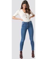 6070f28a2f8b NA-KD Skinny Mid Waist Front Panel Jeans Light Blue in Blue - Lyst