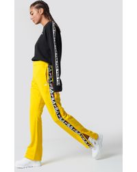 Fila - Thora Track Pants Vibrant Yellow - Lyst