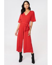 NA-KD - V-neck Wide Sleeve Jumpsuit Red - Lyst