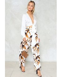 Nasty Gal - No Growing Back Floral Trousers - Lyst