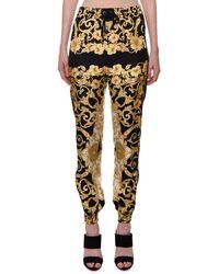 Versace - Hibiscus-print Silk Jogger Pants - Lyst