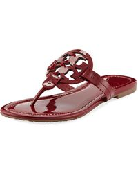 20564b624e7152 Tory Burch - Miller Medallion Patent Leather Flat Thong Sandals - Lyst