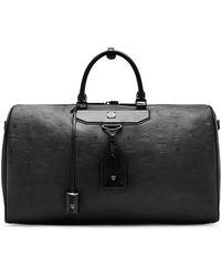 MCM   Nomad Coated Large Leather Weekend Bag   Lyst