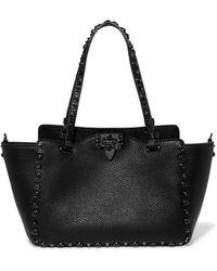 Valentino - Garavani The Rockstud Textured-leather Trapeze Bag - Lyst