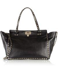 Valentino - Garavani The Rockstud Medium Leather Trapeze Bag - Lyst