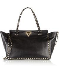 Valentino - The Rockstud Medium Leather Trapeze Bag - Lyst