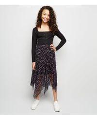db05175946e New Look - Girls Black Floral Mesh Hanky Hem Midi Skirt - Lyst