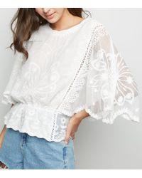 New Look - White Crochet Mesh Sleeve Peplum Blouse - Lyst