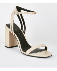 23446a2886614 New Look Wide Fit Gold Strappy Low Block Heel Sandals in Metallic - Lyst