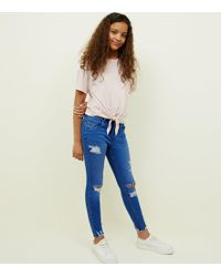 New Look - Girls Bright Blue Ripped Skinny Jeans - Lyst